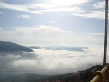 The Moment you are higher than the clouds. The view from above the clouds in Arachova, Greece Stock Photo