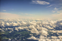 View from above the clouds. Flying over clouds in plane. Royalty Free Stock Image