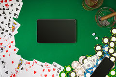 View from above with copy space. Banner template layout mockup for online casino. Green table, top view on workplace. Royalty Free Stock Image