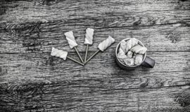 View from above at cup of marshmallows with sticks. royalty free stock images