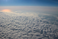 View above the earth at the clouds below Royalty Free Stock Photo