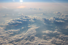 View above the earth at the clouds below. At plane royalty free stock photos