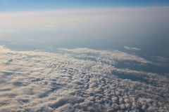 View above the earth at the clouds below. At plane royalty free stock photo