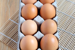 View from above of an eggs on a tray. Directly view from above of an eggs on a tray with wooden table Stock Photos