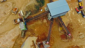 View from above excavator loader in sand quarry. Dumper trucks with cargo sand. Excavator loader in sand quarry. View from above. Aerial view dumper trucks with stock footage