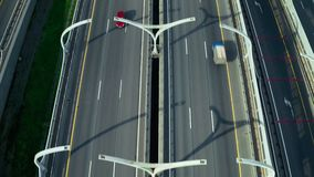 View from above flying drone car traffic on modern highway road in city. View from above flying drone car traffic on modern highway road and intersection in city stock footage