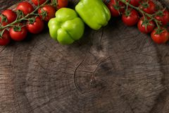 View from above of a Fresh raw vegetables. Tomatoes with green bell paper on a wooden rustic board. Close-up, copy space. Healthy food. Detox concept Stock Image