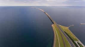 Aerrial view of Korsor Bridge. View from above of Great Belt in Denmark. Cloudy day royalty free stock photo