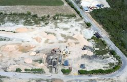 View from above. A huge construction site where sand, clay, crushed stone are stored. Cars stock photo