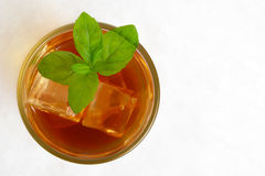 View from above on ice tea,ice cubes,mint on ice on white Stock Photo