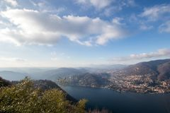 View from above of Lake Como. Panoramic view in winter of Lake C. Omo in Italy with the city of Cernobbio in evidence Royalty Free Stock Photography