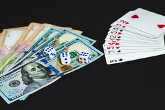 Money, dices and cards on a black background. close-up royalty free stock photos