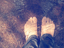View from above of man feet underwater Royalty Free Stock Image