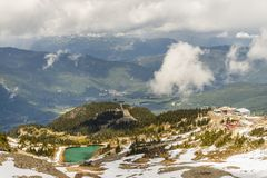 View on above on the mountains covered with forests and snow, la royalty free stock image