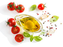 View of above of olive oil with fresh basil leaves and tomatoes Stock Images