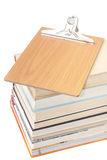 View from above on a pile of books with wooden message board Stock Photography
