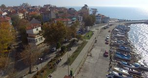 View from above on the Pomorie Embankment near the boat pier in Bulgaria stock video footage