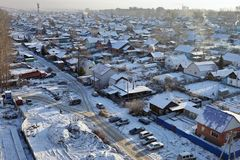 A view from above of a private residential sector on the outskirts of a large city in a frosty winter day. Stock Image