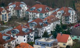 View from above on the residential development of an old part of town, which is today the suburb of a big city, with roofs from royalty free stock images