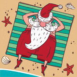 View from above on Santa Claus on the beach. Cartoon carefree Santa Claus in red, lying on the beach by the sea and sunbathing. Around the sand, starfish and Stock Photos