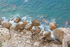 View from Above on the Sea and Stones or Rocks in the City of Taormina. The island of Sicily, Italy. Beautiful and Scenic View of stock image