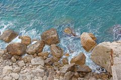 View from Above on the Sea and Stones or Rocks in the City of Taormina. The island of Sicily, Italy. Beautiful and Scenic View of royalty free stock photos