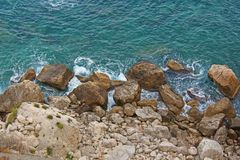 View from Above on the Sea and Stones or Rocks in the City of Taormina. The island of Sicily, Italy. Beautiful and Scenic View of royalty free stock image