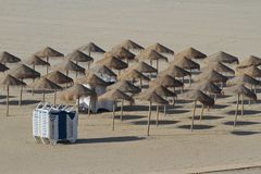 Set of umbrellas and hammocks in the beach Royalty Free Stock Image