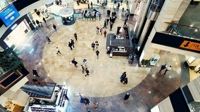 Walking people in shopping mall center. View from above of shopping mall hall. Walking people in shopping mall center stock video