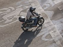 View from above of a single man riding motorcycle on the street in Mexico City, Mexico. Mexico City, D.F. / Mexico - January 09 2016: Man riding motorcycle on Stock Photo