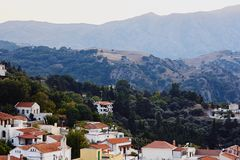 View from above of a small, traditional, Greek village in mountains stock images