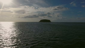 View above of small wild island in the sea stock video footage