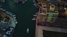 View from above on small yacht during sunset on Mediterranean sea coast near Valencia. Windy and colorful evening in Spain. Filmed on beach without people near stock video footage