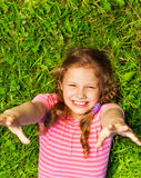 View from above of smiling girl with hands up Stock Images