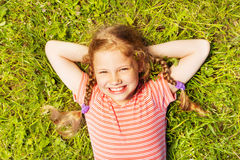 View from above of smiling girl laying on  grass Stock Images