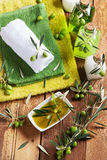 View from above of spa massage setting with green olives Royalty Free Stock Photos