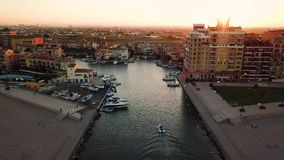 View from above during sunset on Mediterranean sea coast near Valencia. Port Saplaya in Spain.  stock footage