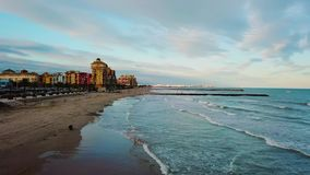 View from above during sunset on Mediterranean sea coast near Valencia. Windy and colorful evening in Spain. Filmed on beach without people near Valencia stock footage