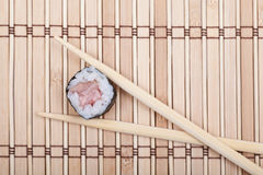 View from above sushi roll on bamboo mat Stock Photos