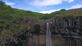 A view from above on Svartifoss and the mountainous terrain. Andreev. stock footage