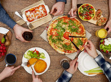 View from above the table of friends eating Stock Image