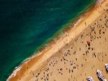 View from above to a busy beach. Coast of the Atlantic Ocean Royalty Free Stock Photography