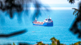 View from above to cargo ship in blue ocean or sea Royalty Free Stock Photos
