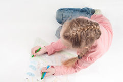 View from above to drawing little girl Stock Photography