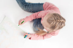 View from above to drawing little girl Royalty Free Stock Photos