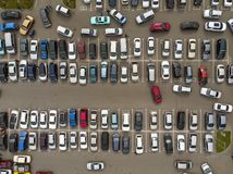 A view from above to the lines of parked cars. Heavy traffic in the parking lot. Searching for spaces in the busy car park. Cruising for parking in dormitory stock photos
