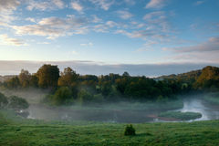 View from above to the small rural river at sunrise Royalty Free Stock Photo