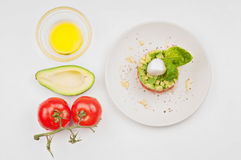 View from above to the tomatoe, avocado and plate Royalty Free Stock Images