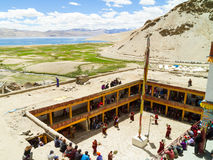 View from above on the Tso Moriri lake and courtyard of the monastery during the Cham Dance Festival royalty free stock photography