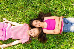 View from above of two beautiful girls on grass Royalty Free Stock Photo